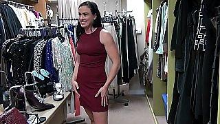Impressive brunette displays her curves