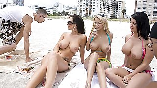 Three hot pussies laying on Miami beach