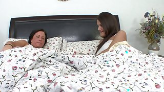 Two petite teens with dark hairs using tongues on each other's twats