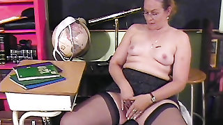 Teacher pinching her nipples and playing with her cunt