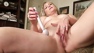Amateur wife with a vibrator pleasures her pussy solo