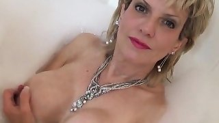 Unfaithful uk mature lady sonia flashes her monster boobies