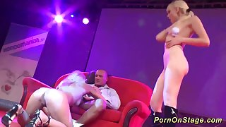 Wild threesome fuck orgy on public european sex fair show stage