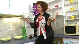 Older mature granny Dana Beranova got so horny while making coffee that she did herself