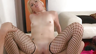 Tattooed woman Missy Mathers touches her muff gently